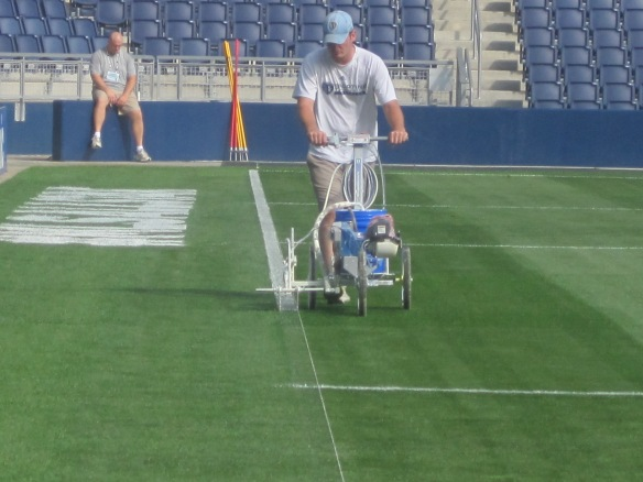 Spraying On Boundaries for MLS All Star Game (Note MLS All Star Logos Behind)