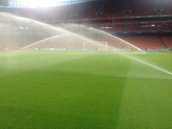 Water Across the Perfect Emirates Stadium Pitch Before Training